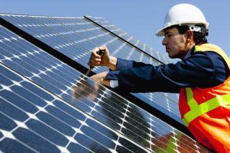 Worker Repairing Solar Power Panel