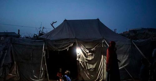 Children Sit At The Entrance To A Tent In A Camp For Internally Displaced People In Mashqafah, Near Aden, Yemen