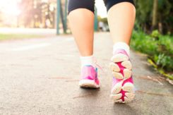 Photo Of Woman Wearing Pink Sports Shoes Walking 1556710