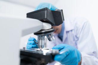 Scientist Using Microscope 3938022
