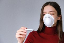 Woman In Face Mask Checking Thermometer 3987152