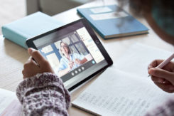 African Child Girl Holding Tablet Talking With Teacher On Distance Video Call.